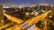 Time Lapse Of Qujiang Road Overpass At Night, Xian Cityscape, China