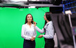 canvas print picture - Presenter, makeup artist and video camera operator working in studio. News broadcasting