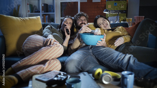 Photo  Friends watching movies together at home