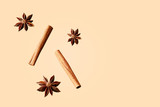 Composition of star anise and cinnamon sticks on a colored background. Star anise and cinnamon sticks flying in a air isolated
