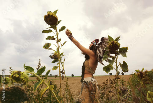 Fotografie, Tablou  An Indian girl is seen in a dried out crop field