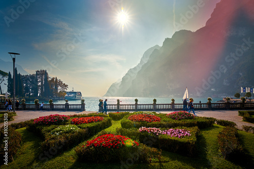 Lago di Garda ,Italy - 13 October 2019:Tourists enjoying a walk around Lake Garda, colorful autumn in Riva del Garda surrounded by mountains, Trentino Alto Adige region, Lago di garda, italy - 310215303