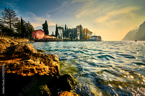 Beautiful and colorful autumn in Riva del Garda, Garda lake surrounded by mounta Wallpaper Mural