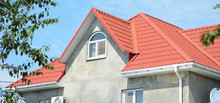 House Roof With Guttering Pipeline And Metal Complicated Roofing Construction