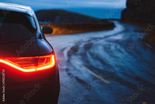 Canvastavla  healight of car on road
