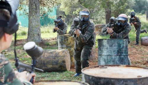 concentrated teams facing on battlefield in outdoor paintball arena Canvas Print
