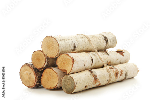 Pile of dry firewood isolated on white background