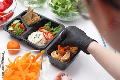 Fototapeta Meal prep. Box diet, healthy balanced meals. Box diet. Appetizing lunch boxes. Food delivered to your doorstep obraz