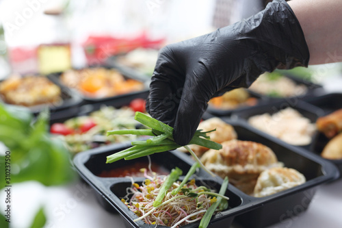 Fototapeta Meal prep containers, the chef prepares a meal in a boxed diet delivered to order. obraz
