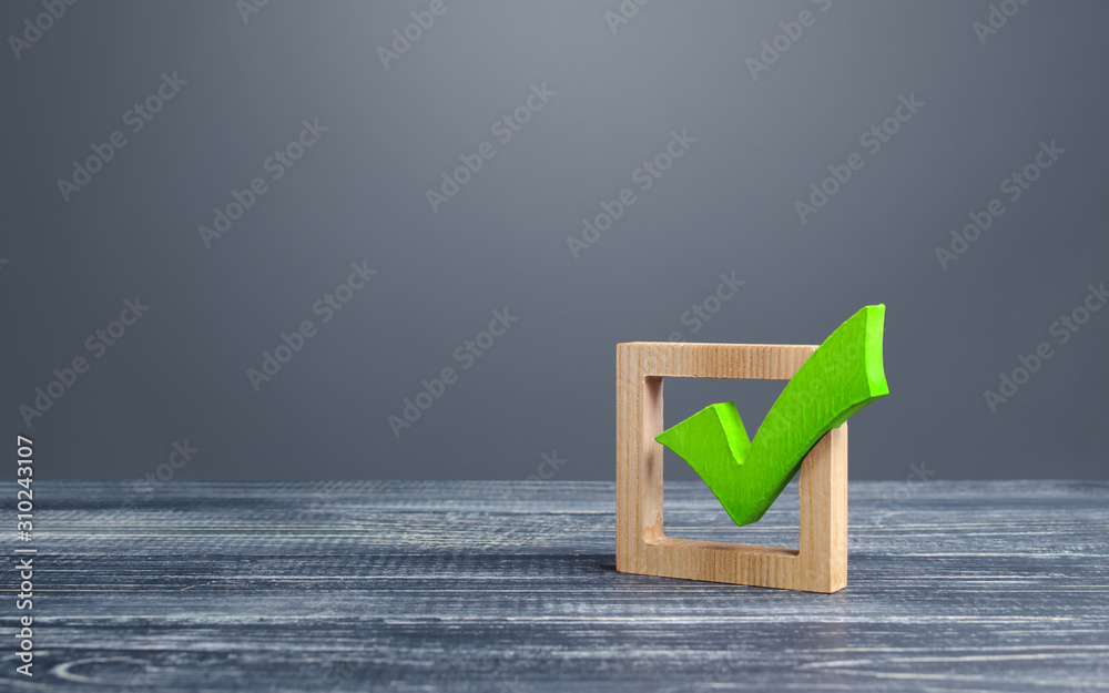 Fototapeta Green voting tick in a box. Checkbox. Democratic elections, referendum. The right to choose, change of power. Checklist for verification and self-discipline. Necessary quality criteria approval symbol