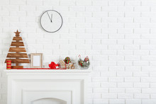 Decorated Fireplace For Christmas Near Brick Wall At Home