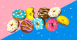Leinwanddruck Bild - Colorful flying toys doughnuts with golden shiny confetti on pink blue background. Creative concept in minimal style.