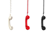 Black, White And Red Vintage Phones Hanging Of A Cable