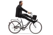 Crazy Businessman Riding A Bic...