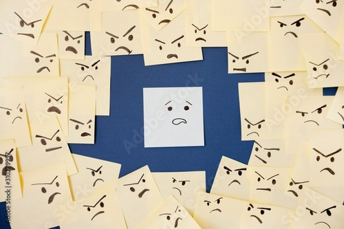 Sticky notes with anthropomorphic face blaming colleague Wallpaper Mural