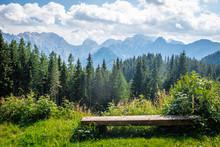 Wooden Bench In Front Of Kamnik–Savinja Alps In Slovenia