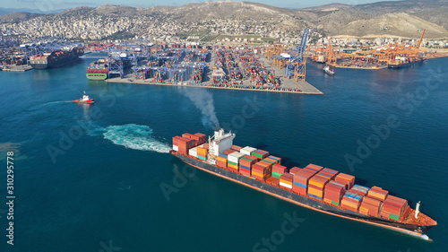 Aerial drone photo of container cargo carrier tanker leaving industrial port of Canvas Print