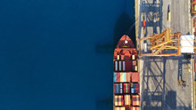 Aerial Drone Top Down Photo Of Industrial Cargo Container Tanker Ship Carrier Docked In Commercial Port Terminal