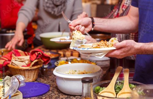 Fotografie, Tablou Potluck dinner gathering in a private home