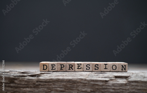 Obraz The word depression on a wood background and dark background - fototapety do salonu