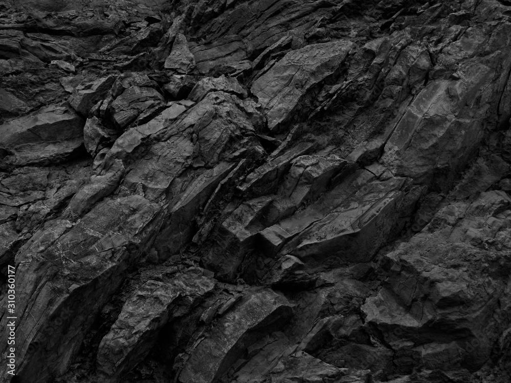 Fototapeta Black rock background. Dark gray stone texture. Black grunge background. Mountain close-up. Distressed backdrop.