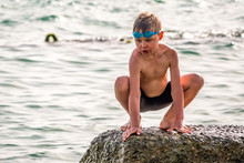 A Boy With Glasses For Swimmin...