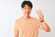 Young Chinese Man Wearing Casual Striped T-shirt Standing Over Isolated White Background Showing And Pointing Up With Fingers Number Three While Smiling Confident And Happy.