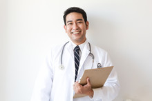 Asian Man In Doctor Uniform On...