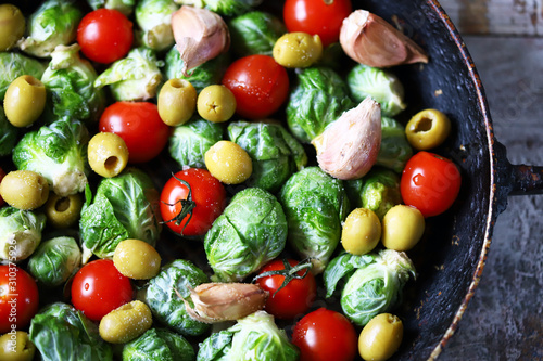 Brussels sprouts with vegetables and herbs in a pan. Cooking Brussels sprouts. Vega food. Selective focus. © Oksana