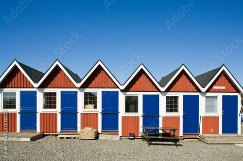Small huts on beach - 310382171