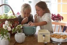 Two Girls Tasting Dough