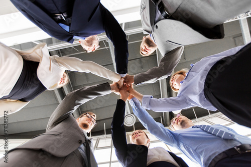 corporate, success and teamwork concept - happy business team making high five at office from below