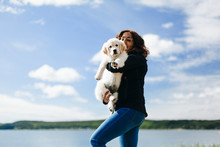 Woman Carry Puppy