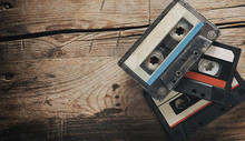 Old Audio Tape Compact Cassettes On Wooden Background