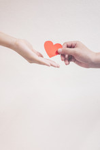 Soft Focus Hand Giving A Red Heart