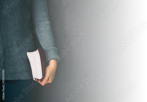 Woman holding the bible in hands and pray with copy space. Fototapete
