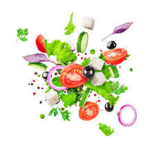 Salad Ingredients Are Flying Isolated On A White Background. Healthy Nutrition