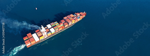 Aerial drone photo of industrial cargo container carrier cruising the open ocean Canvas Print