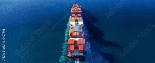 Fototapeta Aerial drone photo of industrial cargo container carrier cruising the open ocean deep blue sea obraz