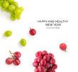 canvas print picture - Creative happy and healthy new year card made of grapes on the white background.  Grapes happy new year, top view, festive greeting card.