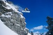 Person On Snowboard Jumping Midair