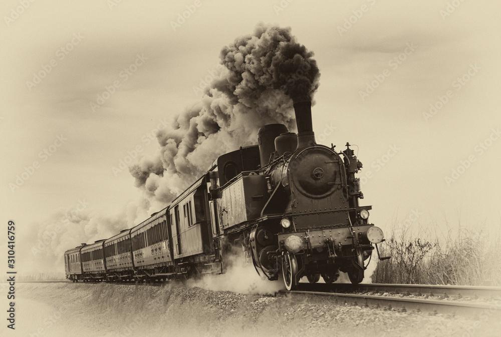 Vintage steam train. Old photo filter applied. - obrazy, fototapety, plakaty