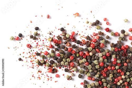 Fotografia Colorful mixed pepper grains and flakes, isolated on white background, top view