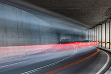 Blurry Stripe Of Car With Red Rear Lights Driving Fast Through The Tunnel