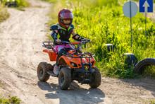 Little Girl Riding ATV Quad Bike In Race Track