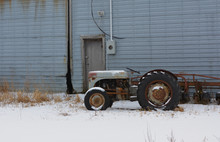 Farm Tractor In The Winter