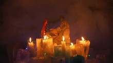 Burth Of A Jesus Installation Inside Of Snow Igloo House With Colorful Icy Plafonds And Burning Candles In Them In Cold Winter Night. Joseph And Mary Holding The Newly Born Jesus.