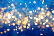 Blue festive background with sparkles in the bokeh. The concept of the celebration, the day of Christmas, New Year, birthday, ceremonies, events, etc.