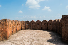 Jaigarh Fort Walls In A Circle Shape With Square Holes To Observe The City