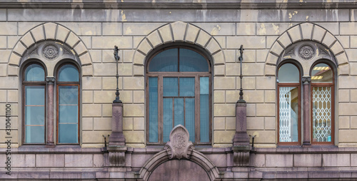 Three windows in a row on the facade of the urban historic building front view, Canvas Print